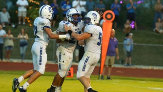 Bishop Chatard's Daylen Taylor (middle) celebrates during his team's 35-7 victory over Guerin Catholic on Friday. Taylor finished with 22 rushes for 103 yards and two touchdowns, and tacked on a 3-yard receiving touchdown.