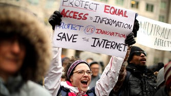Demonstrators rally outside the Federal Communication Commission building to protest against the end of net nutrality rules Dec. 14, 2017 in Washington, DC.