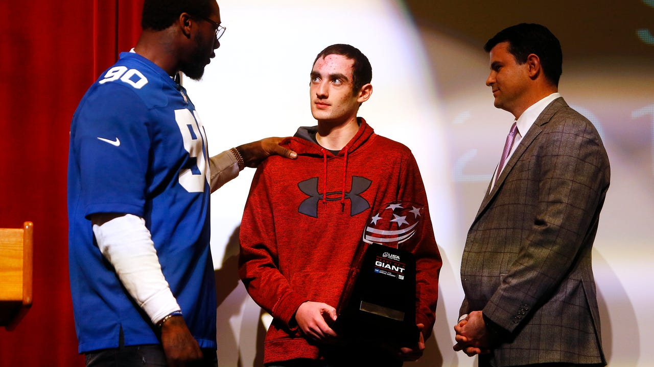 Mendham High School's Sebastian Quinn is year's recipient of USA Football's Heart of a Giant Award, Quinn who is fighting ALCL non-Hodgkin's Lymphoma  was surprised by the Giants Jason Pierre-Paul.