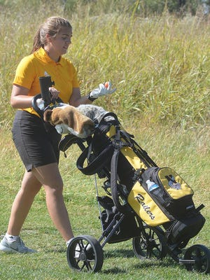 Newton High School golfer Lindsey Warsnak heads to the ninth hole tee box Tuesday at Sand Creek Station at the AVCTL-I championships. Warsnak missed a medal by one stroke, tying for 14th.