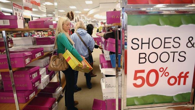 Melissa Key, AP Kelsey Parrish shops for boots on Black Friday at Berkeley Mall in Goldsboro, N.C., Friday, Nov. 28, 2014.