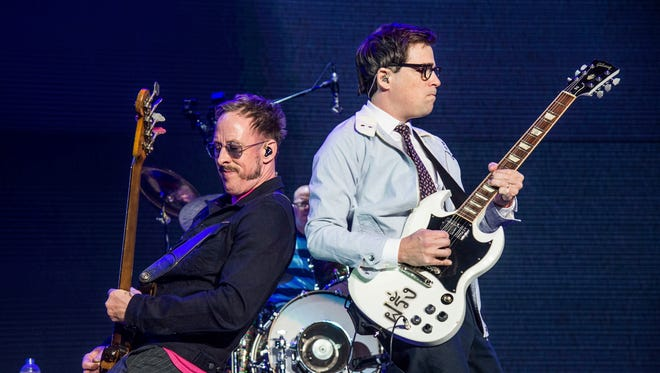 Scott Shriner, left, and Rivers Cuomo of Weezer perform in 2017.