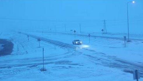 Snow piles up Monday morning at the junction of highways 281 and 20 near Mellette in northern South Dakota.