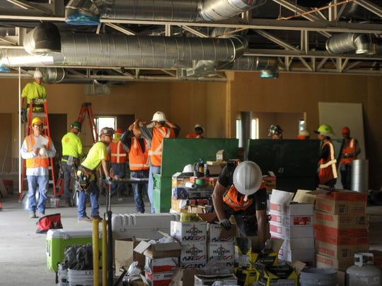 ROB VARELA/THE STAR Construction workers work in what will be the training room at the Rams practice facilities on the campus of CLU in Thousand Oaks.