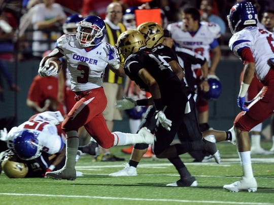Thomas Metthe/Reporter-News Cooper running back Tyrees Whitfield (3) runs the ball past Abilene High defenders during the fourth quarter of the Cougars' 55-38 loss to Abilene High in the crosstown football game on Friday, Sept. 9, 2016, at Shotwell Stadium.