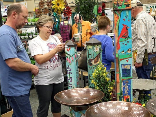 Patrick Johnston/Times Record News Shoppers look through the Smith's Gardentown Farms booth at the 19th Annual Arts Alive! Home & Garden Festival at the Multi-Purpose Events Center.