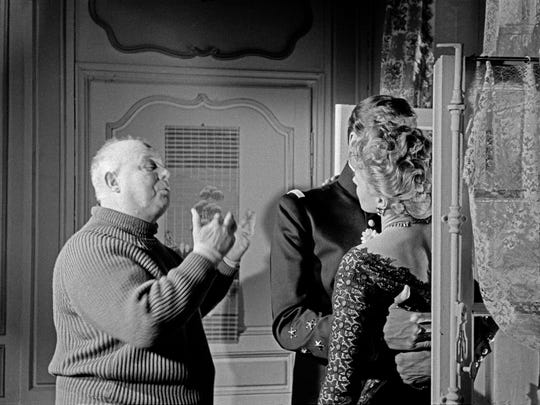 "French film director Jean Renoir during the filming of 'Elena and Her Men'  (""Elena et les hommes"") with U.S. actor Mel Ferrer and Swedish actress Ingrid Bergman. Ile de France region. Boulogne-Billancourt studios. 1956."