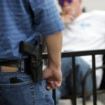 Ann Arbor Public Schools can continue to ban guns in schools, a judge ruled today.