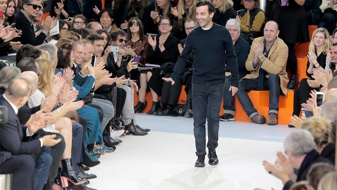 AP French fashion designer Nicolas Ghesquiere is applauded at  Paris Fashion Week in March. He will launch his 2015 Cruise collection Wednesday at the Bob Hope house in Palm Springs. French fashion designer Nicolas Ghesquiere  receives applause at the end of Louis Vuitton's Fall-Winter 2015-2016 ready-to-wear fashion collection during the Paris Fashion Week, Wednesday, March 11, 2015.  in Paris, France. (AP Photo/Jacques Brinon)