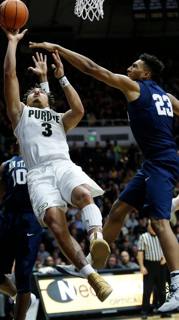 Carsen Edwards scores over Josh Reaves of Penn State