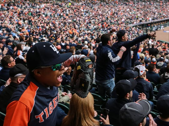 Cole Clark of Detroit cheers on the Detroit Tigers as they play the Minnesota Twins during Opening Day at Comerica Park in downtown Detroit on Monday April 6, 2015.