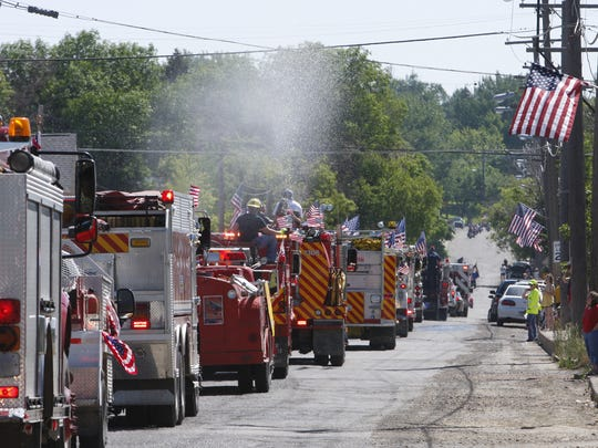 Fire trucks from Black Eagle and the surrounding area drive down Smelter Ave. during the Black Eagle 4th of July parade