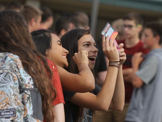 Foothill High school student Chloe David, center, watches