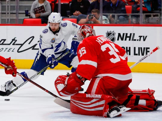 Lightning center Tyler Johnson (9) shoots against Red Wings goalie Jimmy Howard (35) in the first period on Monday, Oct. 16, 2017, at Little Caesars Arena.