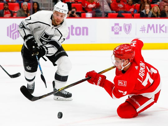 Red Wings center Dylan Larkin (71) takes a shot defended by Kings defenseman Oscar Fantenberg (7) in the second period on Tuesday, Nov. 28, 2017, at Little Caesars Arena.