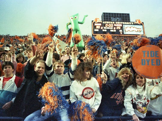 Auburn fans cheer after the Iron Bowl at Jordan-Hare Stadium in Auburn, Ala., on Dec. 2, 1989. Auburn defeated Alabama 30-20.