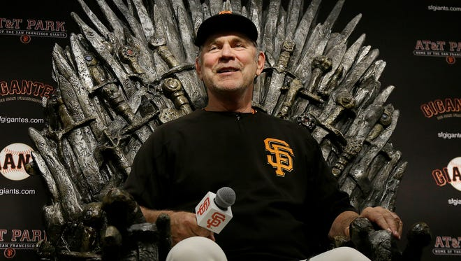 San Francisco Giants manager Bruce Bochy sits in a chair as part of the team's Game of Thrones promotion at a news conference after a baseball game between the Giants and the Indians last season.