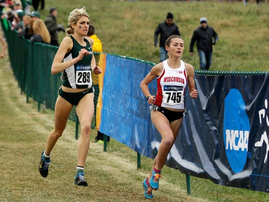 Michigan State's Rachele Schulist, left, and Wisconsin's Sarah Disanza run in the women's NCAA Division I Cross-Country Championships on Saturday.