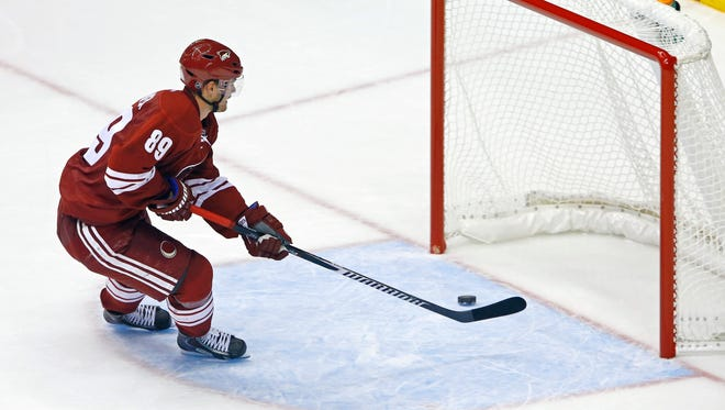 Arizona Coyotes left wing Mikkel Boedker (89) scores an empty net goal against the Edmonton Oilers during the third period of their NHL game Wednesday, Oct. 15, 2014 in Glendale, Ariz.  The goal marked Boedker 's first career hat trick.