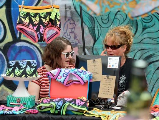 Nicole Grove of Dillsburg, left, talks with her mother,