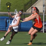 Mamaroneck's Sophie Miller (20) Scarsdale's Jilly Mehlman (8) during girls lacrosse game at Scarsdale High School on April 27, 2016. Mamaroneck defeats Scarsdale 9-7.