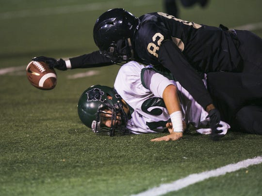 Whitehaven linebacker Devon Robinson (82) attempts to grab a loose ball after Cordova quarterback Christian Arrambide fumbles in the second quarter at a game this season.