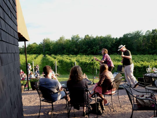 Abbie Morin and Tom Pearo play on the deck outside tasting room at Shelburne Vineyard in Shelburne on July 2.