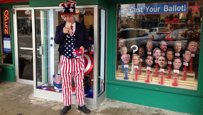 The Theatrical Shop in West Des Moines Valley Junction in Iowa invited shoppers to pick their favorite presidential candidate with an Iowa caucus window display.