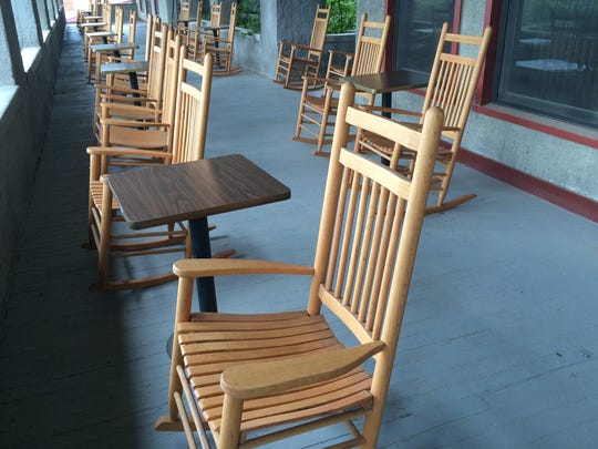 Rocking chairs dot the front porch of the Peace Valley Hot Springs outside Boulder.