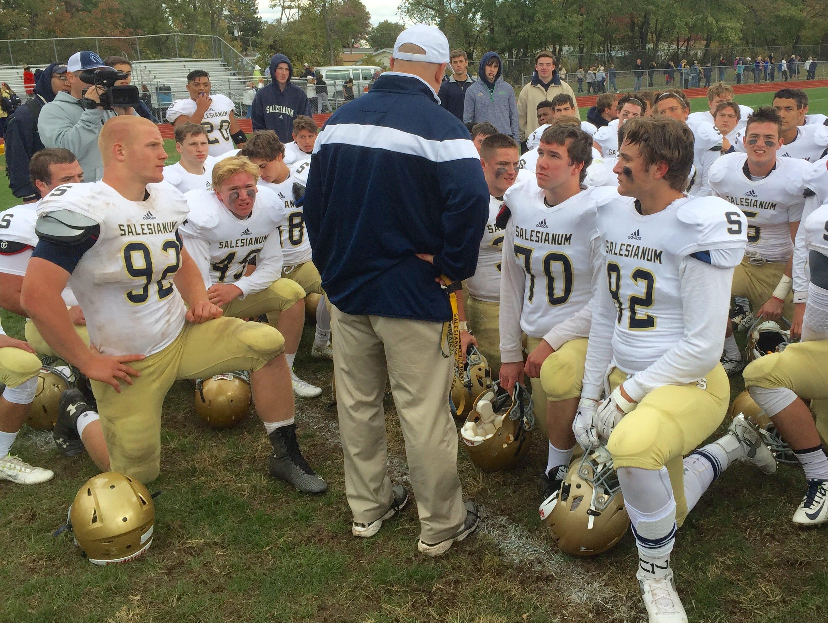 Salesianum coach Bill DiNardo addresses his team after a 34-8 win at Concord on Saturday.