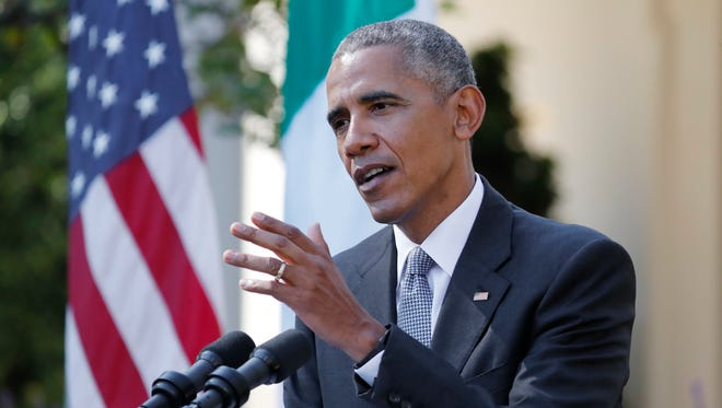 President Obama answers a question during a joint news conference with Italian Prime Minister Matteo Renzi in the Rose Garden of the White House Tuesday.