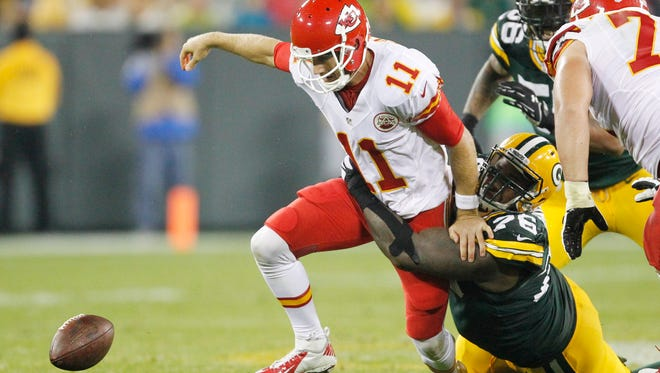 Kansas City's Alex Smith tries to track down a fumble as he is sacked on Monday night.