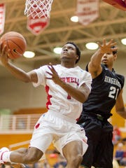 Cornell's Darryl Smith goes up for a layup at Newman