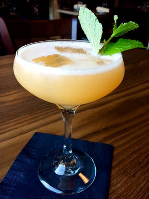 """Hemingway's Bar and Hideaway: """"Stranger to None"""" cocktail, Cathead's Bristow Gin and fresh cantaloupe juice."""