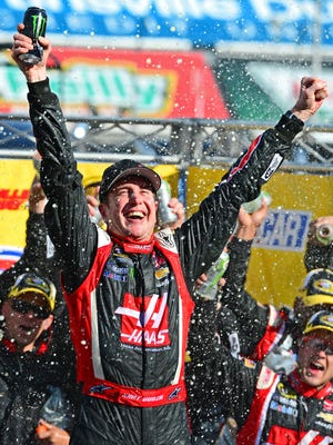 Kurt Busch celebrates in victory lane after winning the STP 500 at Martinsville Speedway, his first win since October 2011.