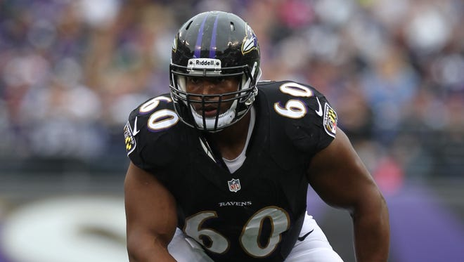 Baltimore Ravens tackle Eugene Monroe (60) in action against the Green Bay Packers at M&T Bank Stadium.