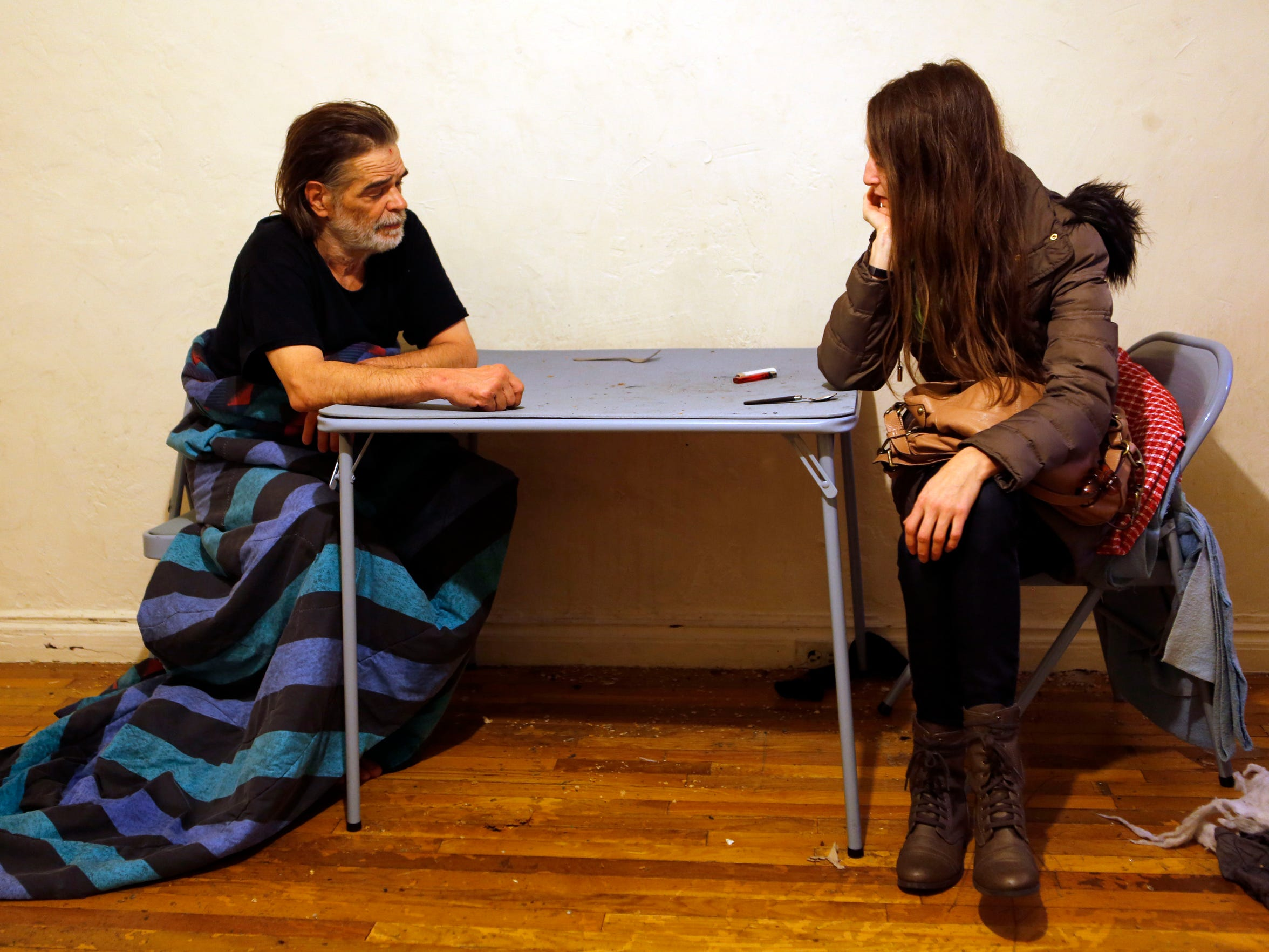 Jonathan's caseworker meets with him in his new apartment.