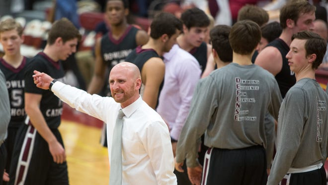 Dowling High School head coach Mike O'Connor yells to his team during a timeout in the second quarter Friday, Jan. 15, 2016, at Ankeny High School.