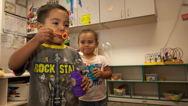 Jayden Chavez, left, 2, and Dayan Chavez, 2, blow bubbles in their classroom Monday, June 20, 2016, in their Jardín de los Niños classroom. Jardín helps care for and educate homeless and near-homeless children. The nonprofit is one of many in the community aimed at helping to alleviate factors that led to New Mexico ranking 49th overall for child well-being, according to a Kids Count report.