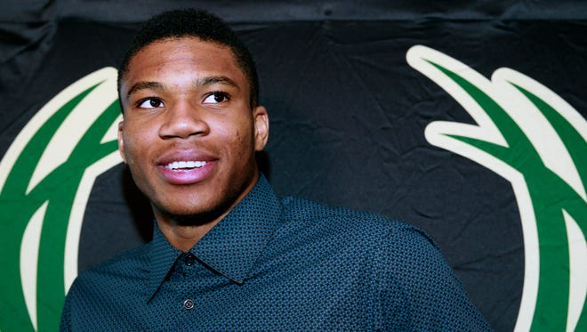Giannis Antetokounmpo talks with media following a news conference by the Milwaukee Bucks to announce his four-year, $100 million contract extension on Tuesday at the WESC Preview Center.