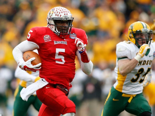 Jan 10, 2015; Frisco, TX, USA; Illinois State Redbirds quarterback Tre Roberson (5) runs for a touchdown in the fourth quarter against the North Dakota State Bison in the Division I championship at Pizza Hut Park. North Dakota State beat Illinois State 29-27. Mandatory Credit: Tim Heitman-USA TODAY Sports