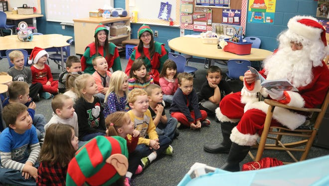 PCHS National Honor Society students played the role of Santa and his elves when visited Bataan kindergarten classed to read 'Snowman Magic' on Wednesday.