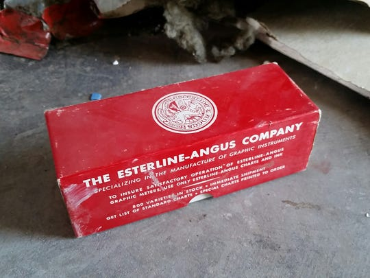 A box of rolled paper made by the Esterline-Angus Co. was among debris littering the Tortugas South Observatory last week. The now-deteriorating building once hosted two telescopes, but it fell out of use. New Mexico State University plans to tear it down starting Wednesday.