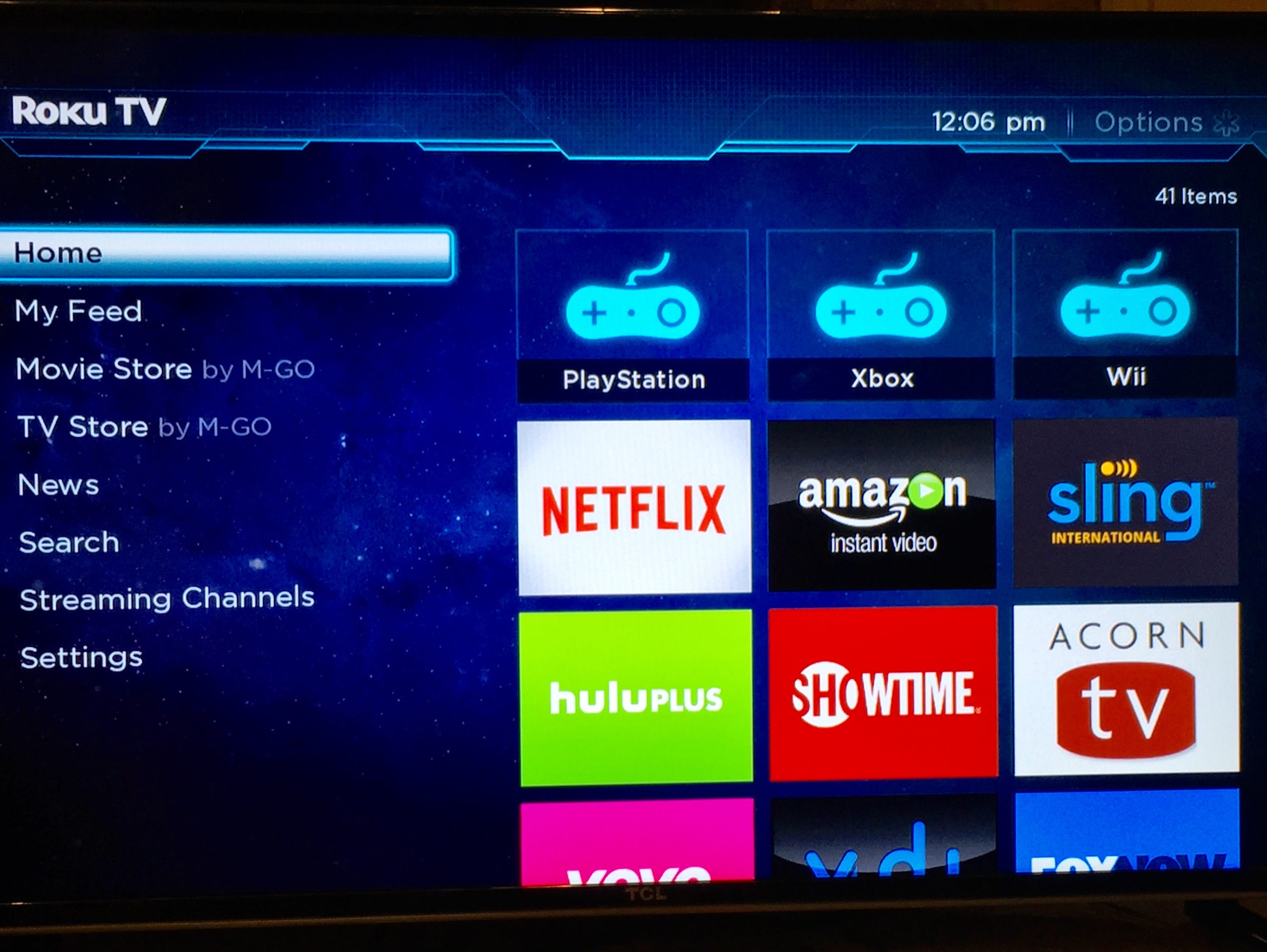 A photo of TCL's 40-inch Roku TV with menu displayed.