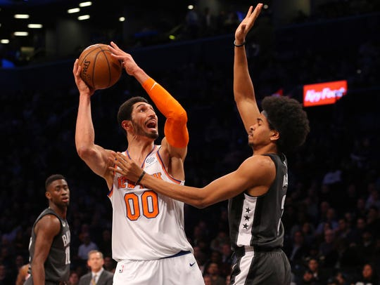New York Knicks center Enes Kanter (00) controls the
