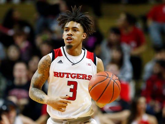 Rutgers Scarlet Knights guard Corey Sanders (3) dribbles