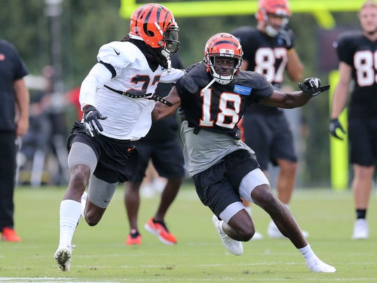 Cincinnati Bengals wide receiver A.J. Green (18) runs his route as Cincinnati Bengals defensive back Dre Kirkpatrick (27) defends during Cincinnati Bengals training camp practice, Saturday, Aug. 11, 2018, at the practice fields next to Paul Brown Stadium in Cincinnati.