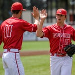 """UL pitcher Trace Guidry (11) high-fives pitcher Evan Guillory (18) after Guillory completed a double play at first base during the third inning of an NCAA baseball game against Arkansas State at M.L. """"Tigue"""" Moore Field in Lafayette Sunday."""