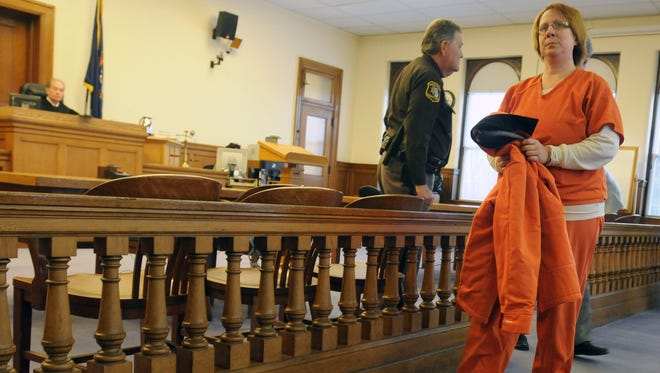 Sara Ylen is led out of the courtroom after pleading no contest to healthcare fraud at the Sanilac County Courthouse.