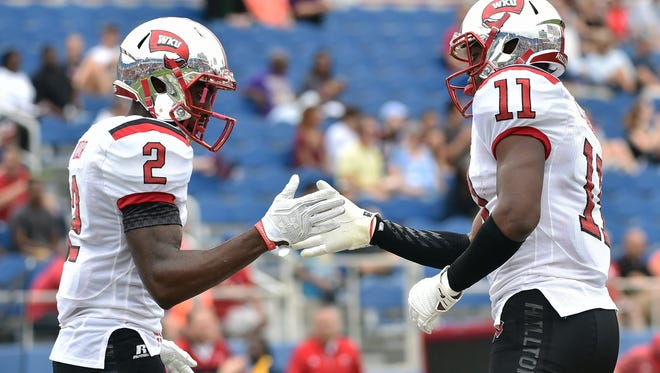 Western Kentucky Hilltoppers wide receiver Lucky Jackson (right) celebrates his touchdown with Hilltoppers wide receiver Taywan Taylor (left) in the end zone during the first half against Florida Atlantic Owls at FAU Football Stadium.